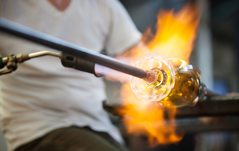 A Glass Blower Works On A Glass Of Wine