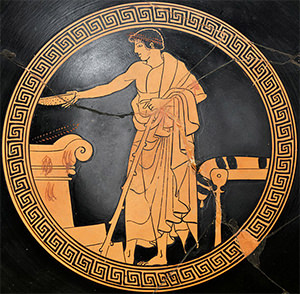 A libation being poured at a symposium (Attica red-figure cup, ca. 480 BC)