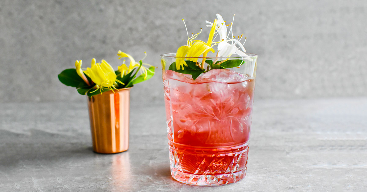 A low-proof, refreshing riff on the classic Old-Fashioned, this summer cocktail uses rose Port and honeysuckle simple syrup. Learn how to make it with this recipe.