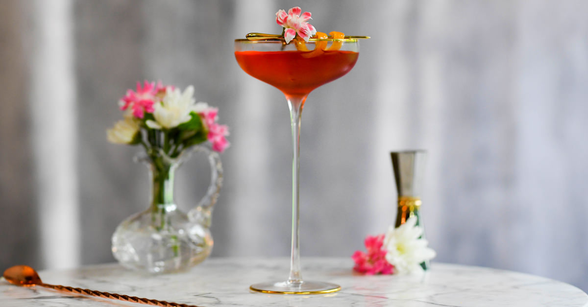 The Sazerac, a classic cocktail from New Orleans, gets a reboot with rye, Peychaud's simple syrup, and orange bitters. Learn how to make it with this recipe.