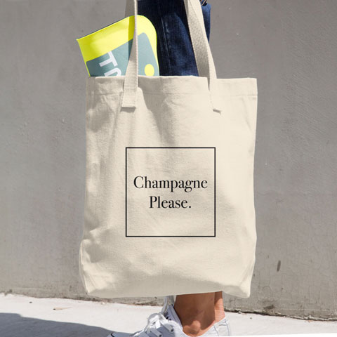 "Tote bag with ""Champagne Please"" graphic"
